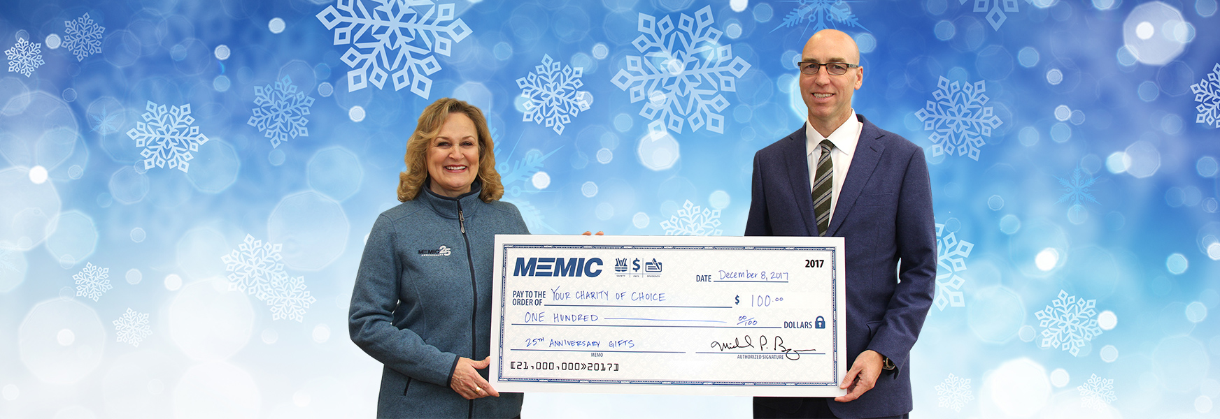 Catherine Lamson and Mike Bourque with big check