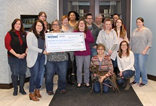 MEMIC employees give Animal Refuge League of Greater Portland a donation