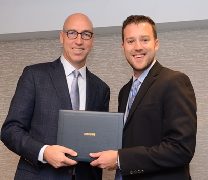 CEO with employee holding his WCP diploma