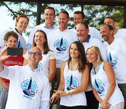 Group photo of MEMIC employees in Beach to Beach race shirts