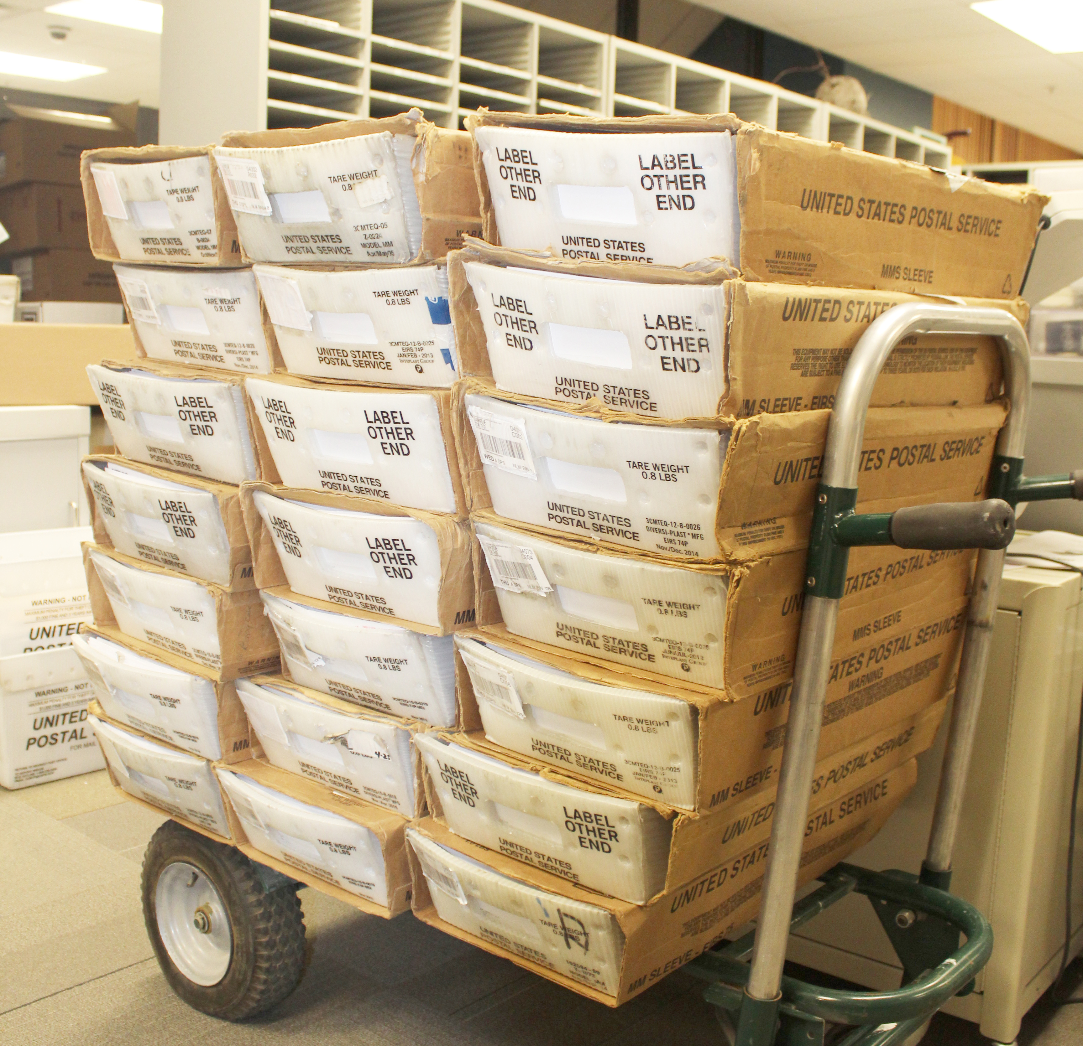 mailcart full of boxes of mail