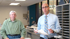 John Stahl and Mike Bourque in MEMIC mail room with dividend checks