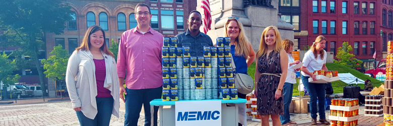 MEMIC employees participating in United Way food can drive