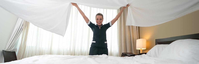 housekeeper making bed