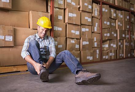 Injured worker in warehouse