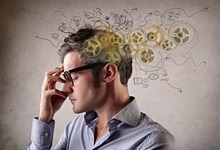 Man thinking with cogs and scribbled notes surrounding head