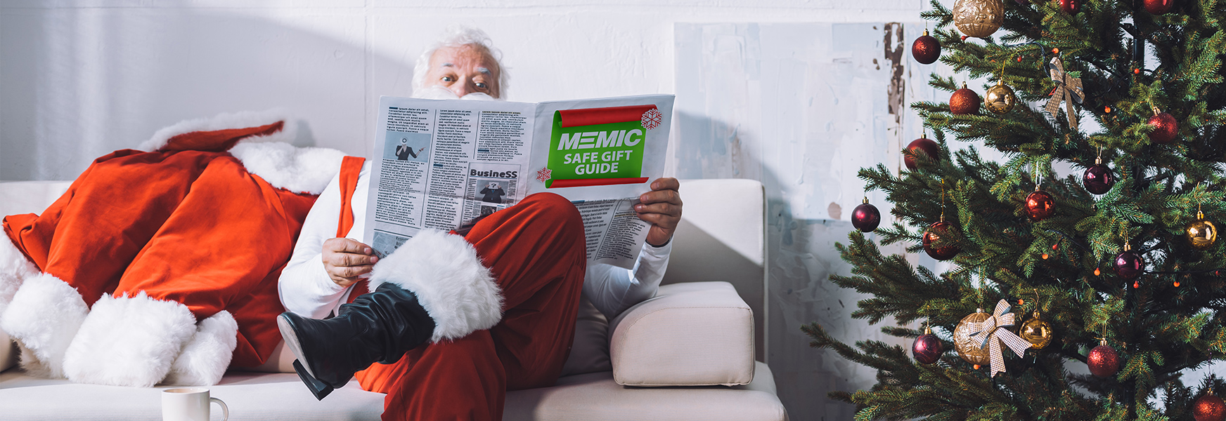 Santa Claus reading MEMIC Safe Gift Guide