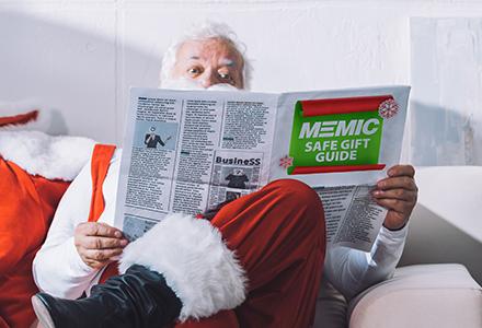 Santa Claus reading MEMIC Safe Gift Guide