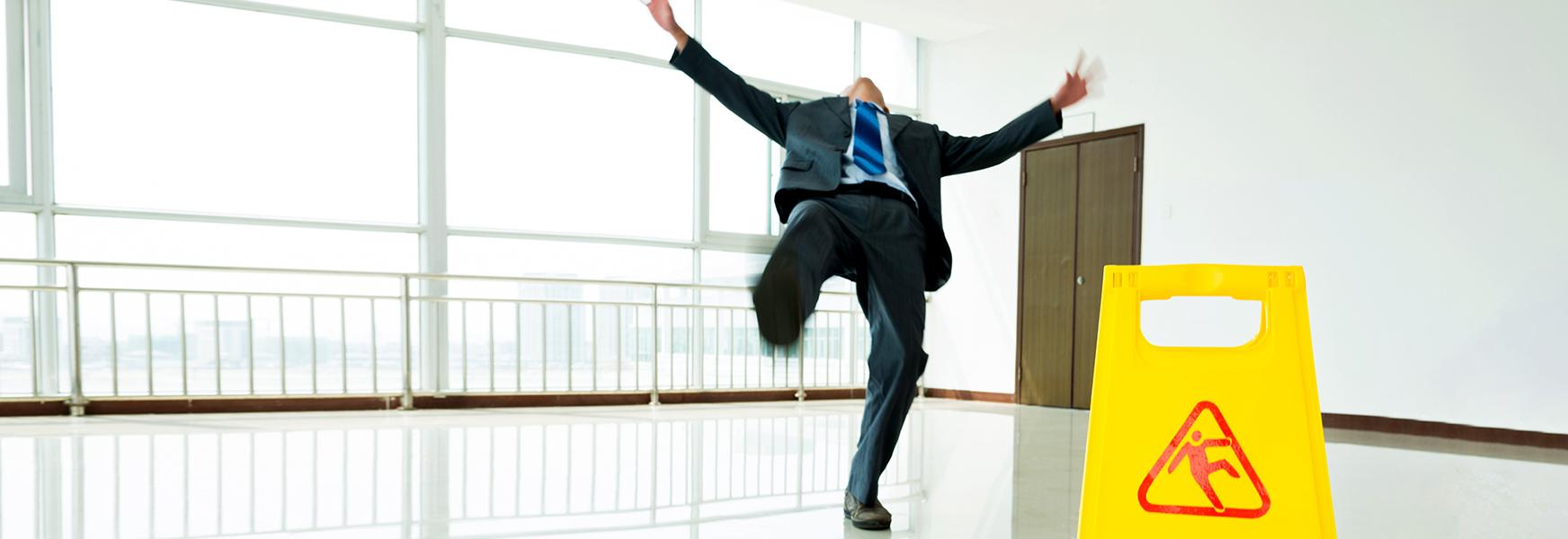 man slipping on floor