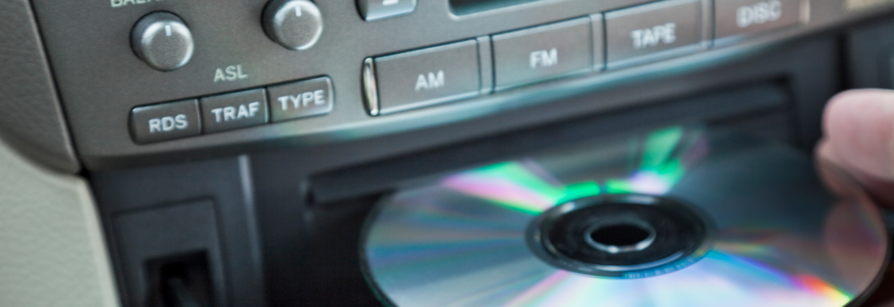 Music CD being loaded into CD player