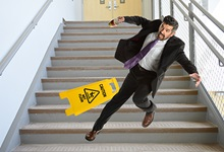 Man falling down wet stairs