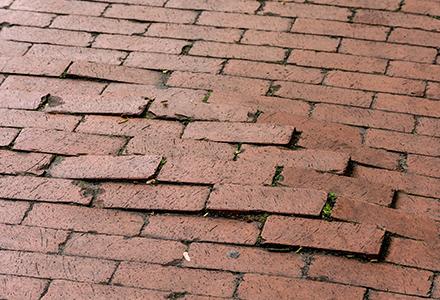 uneven brick pavement