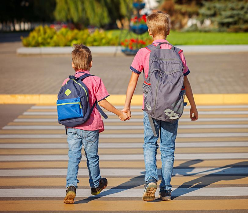 kids walking in the crosswalk