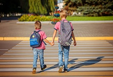 kids walking in the crosswalk