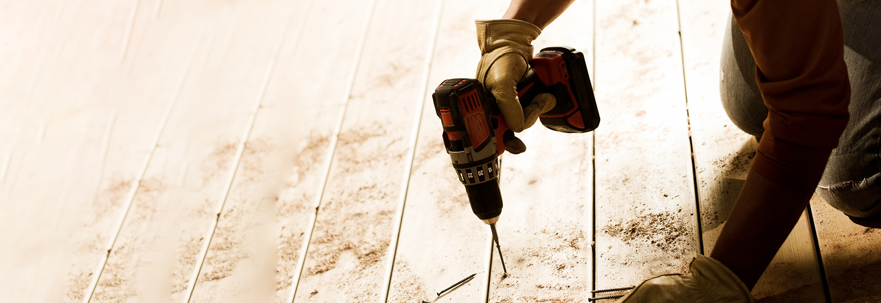 Worker using power drill