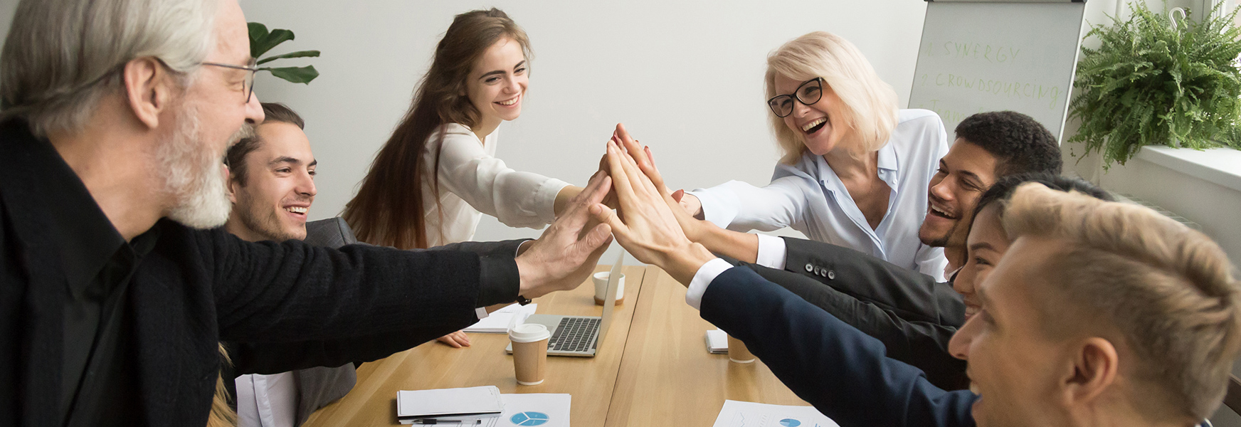group of co-workers high-fiving