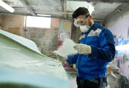 Man repairing boat