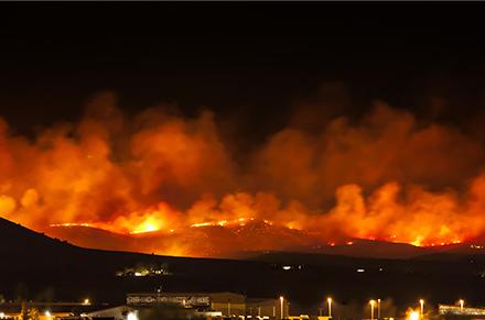 mountainous wildfires burning at night
