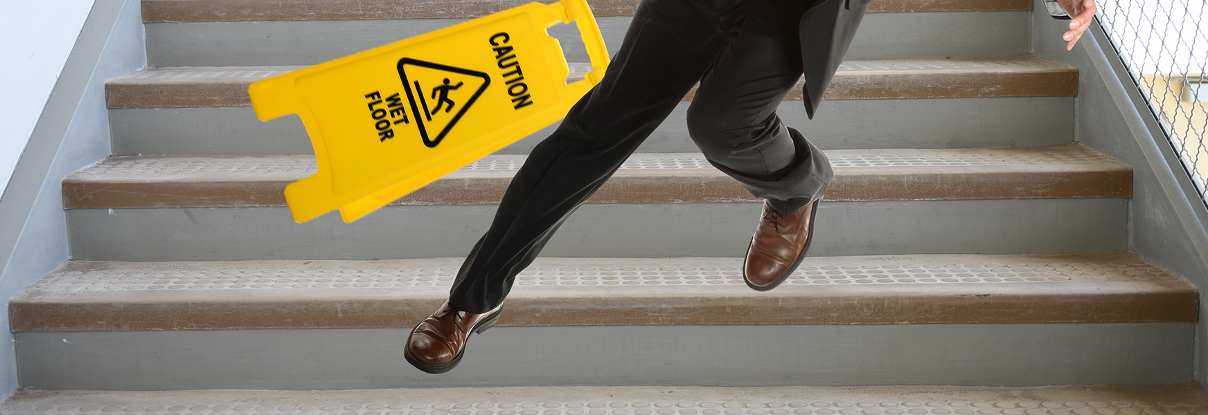 A man slipping and falling down the stairs.