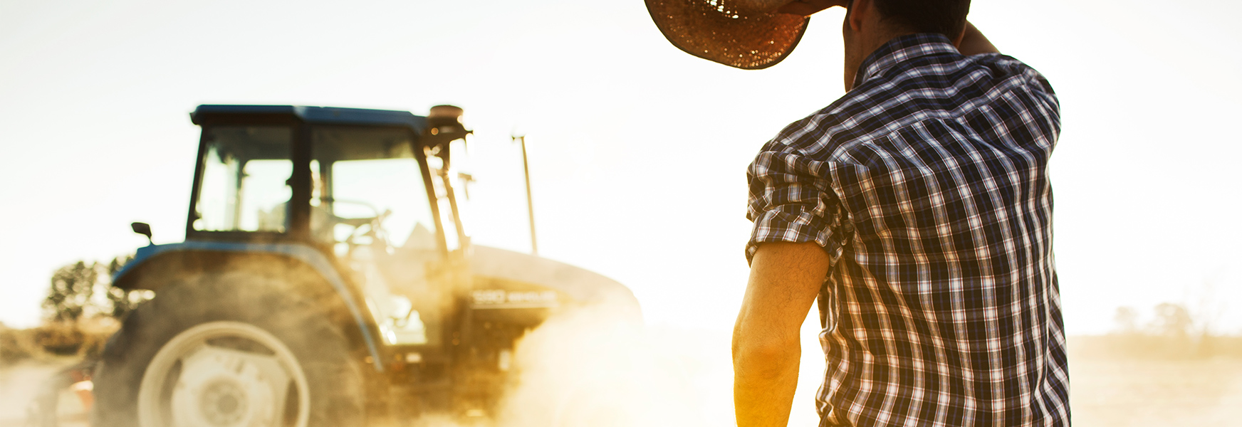 Man with tractor working in the hot sun