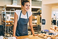 Young Girl Working At Bakery