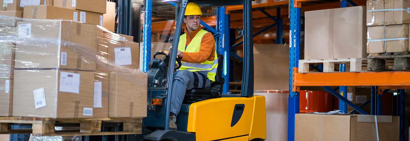 Worker Operating a Forklift