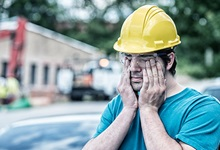 Drowsy Construction Worker Rubs Eyes