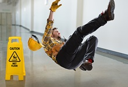 Worker slipping on wet floor