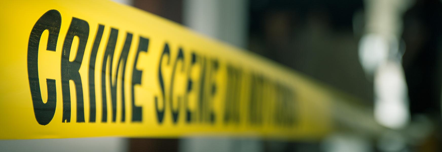 crime scene tape hanging in office