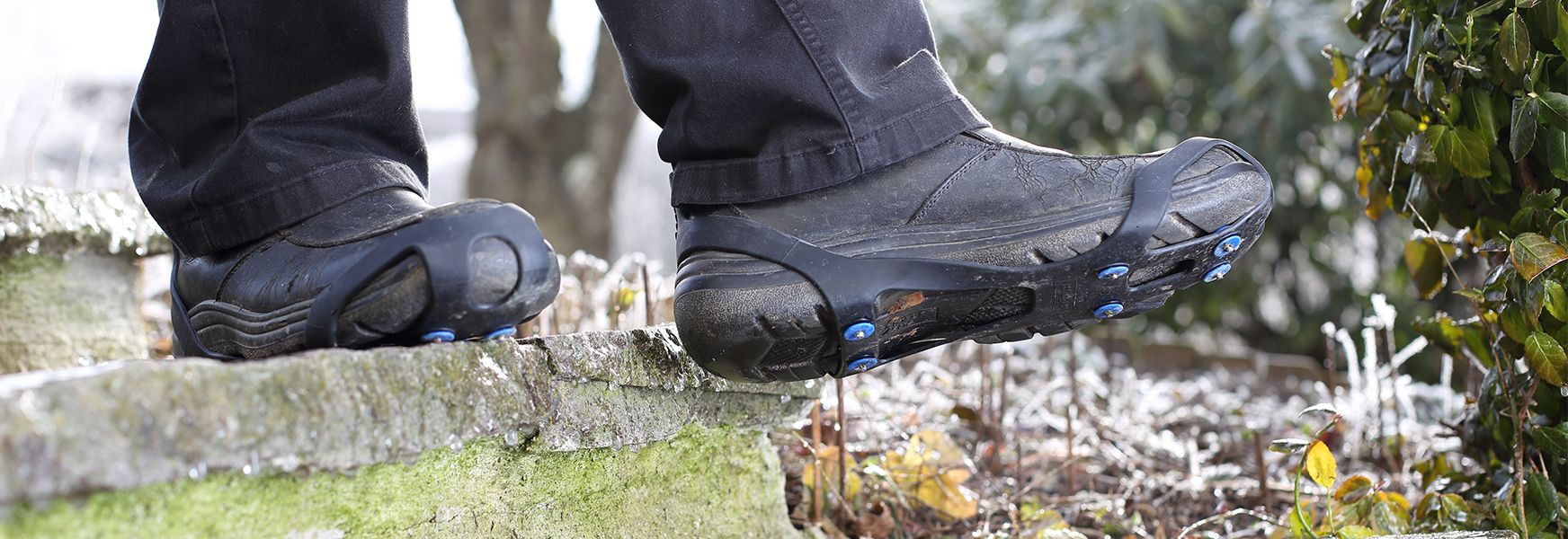 Boots equipped with traction enhancers.