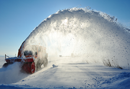 Snow machine removing snow