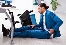 Office worker injured after falling out of chair