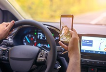 Distracted driver using cellphone to pictures of himself