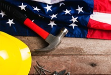 Hardhat and tools on American flag