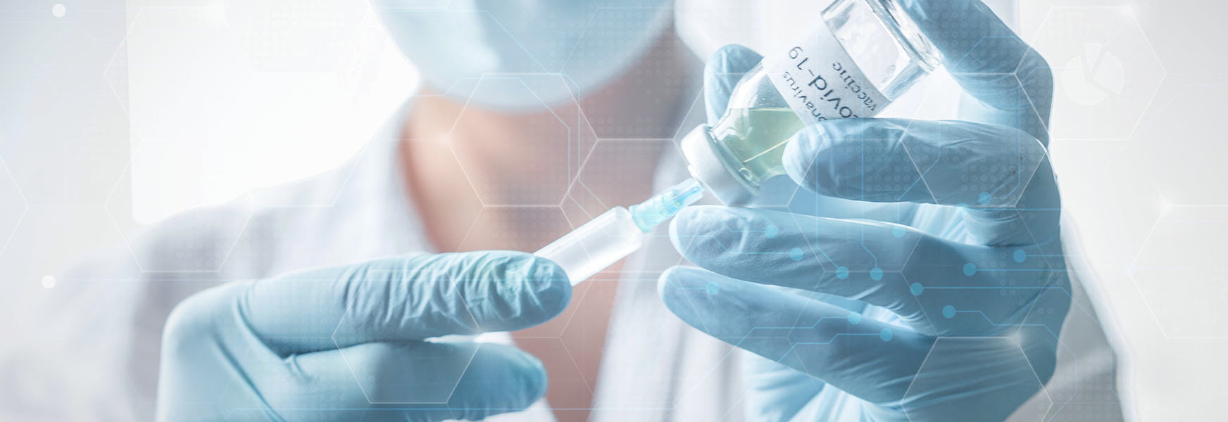 Healthcare worker prepares COVID-19 vaccine