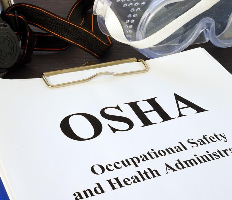 OSHA forms in a binder.