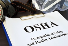 OSHA forms in a binder.