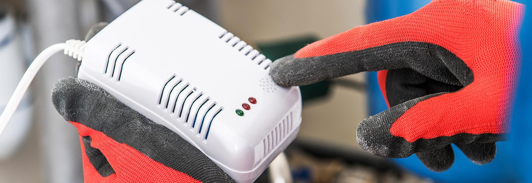 Technician Installing Carbon Monoxide Detector