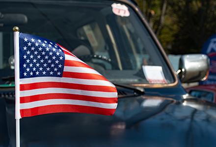 American flag on hood of pickup truck