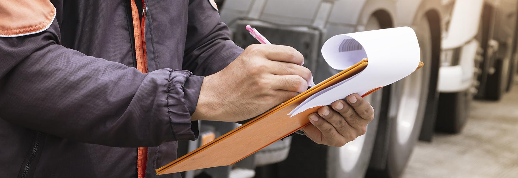 Worker writing on clipboard
