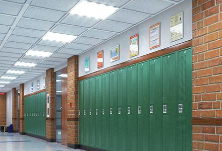 Empty school hallway with green lockers