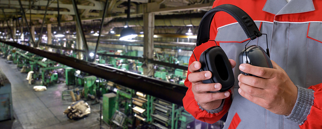 worker with ear protection in manufacturing facility