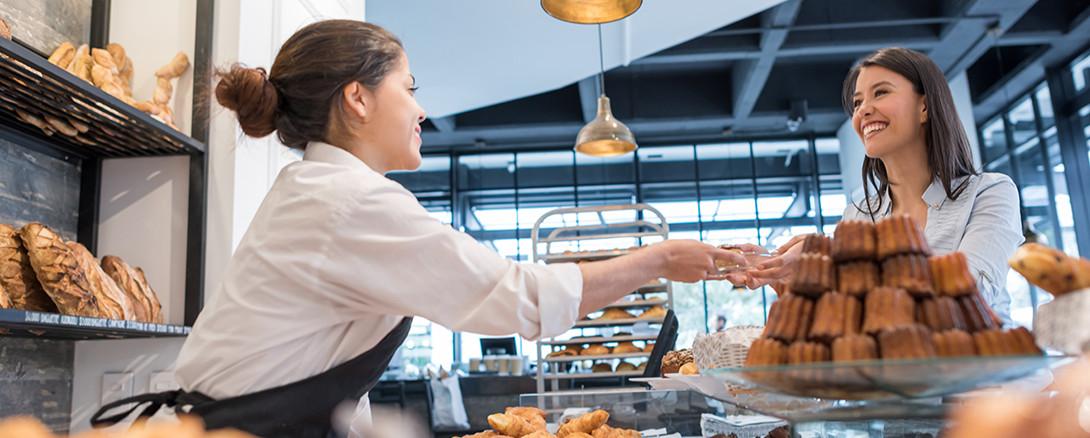 bakery worker helping customer