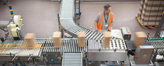 Factory worker at conveyor belt