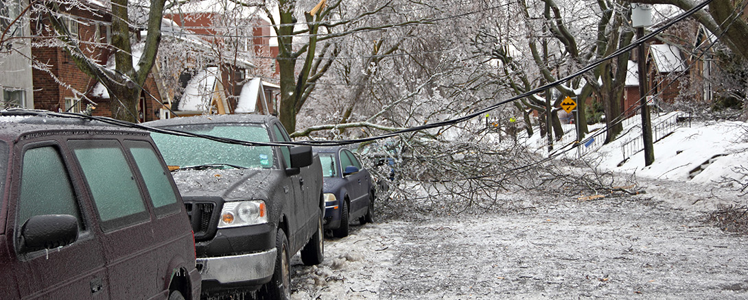 Damage to street and cars caused by winter storm