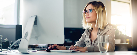 Woman at computer watching a training video