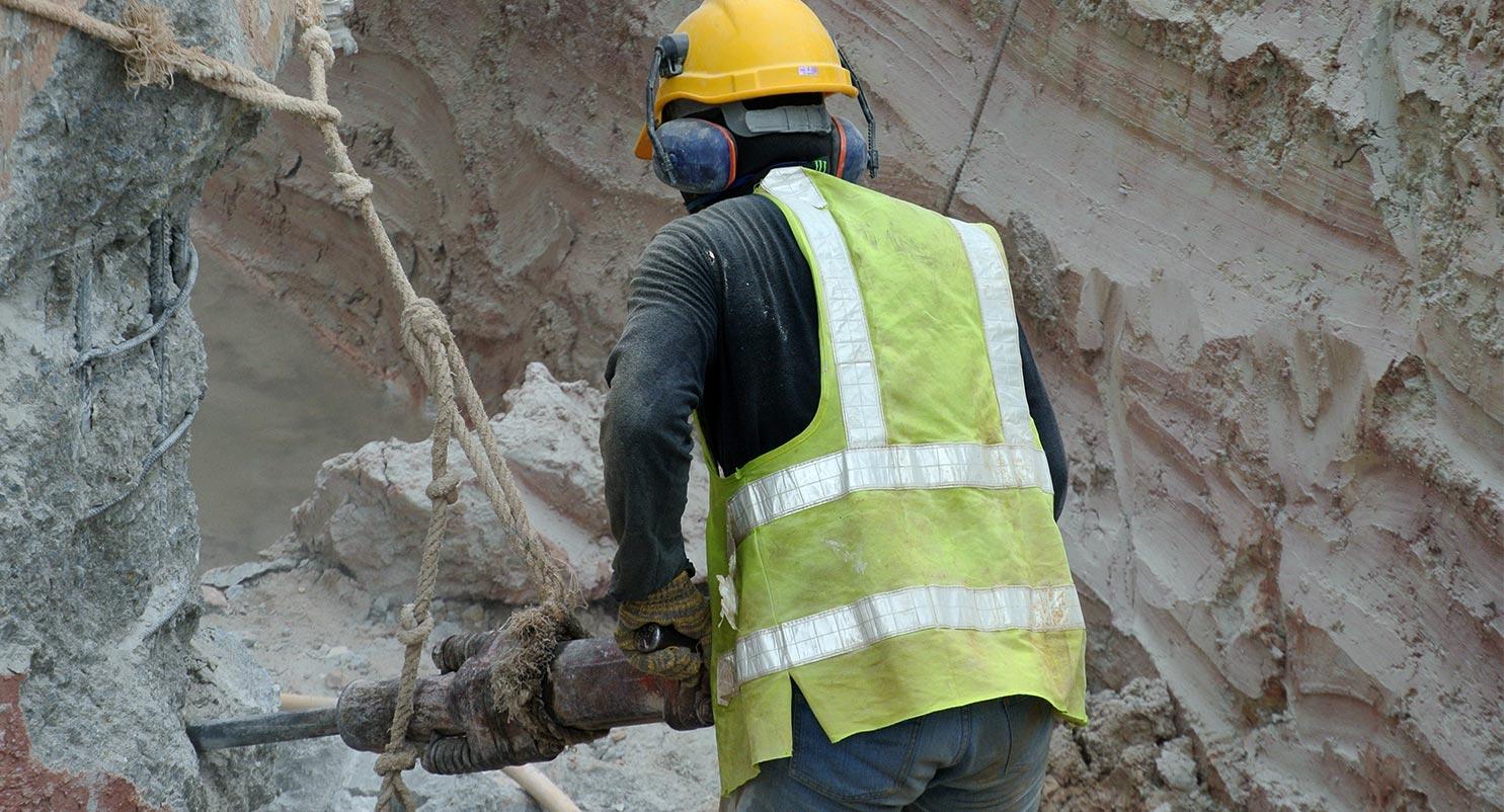 worker using jackhammer