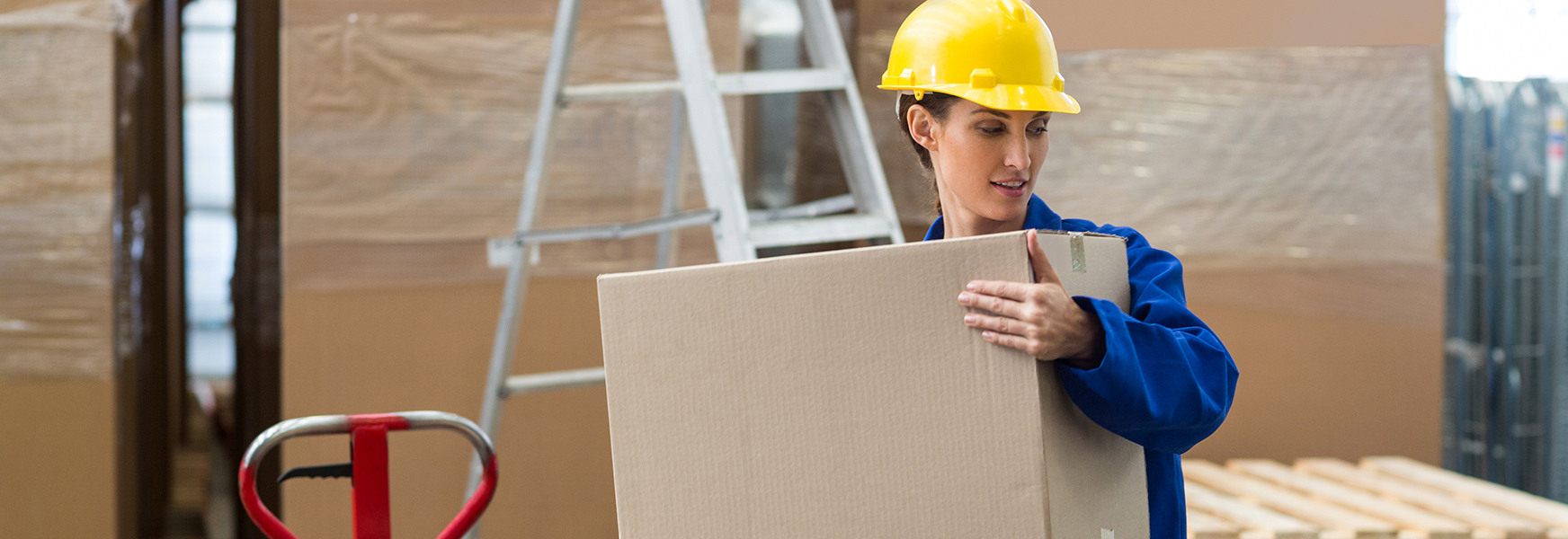 Woman lifting box in power zone