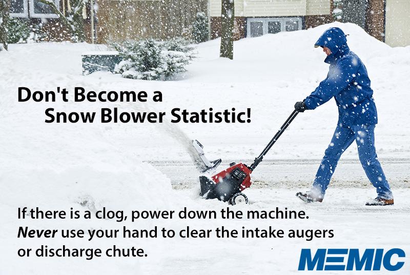 Man snowblowing a driveway.