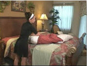 Housekeeper putting case on pillow.